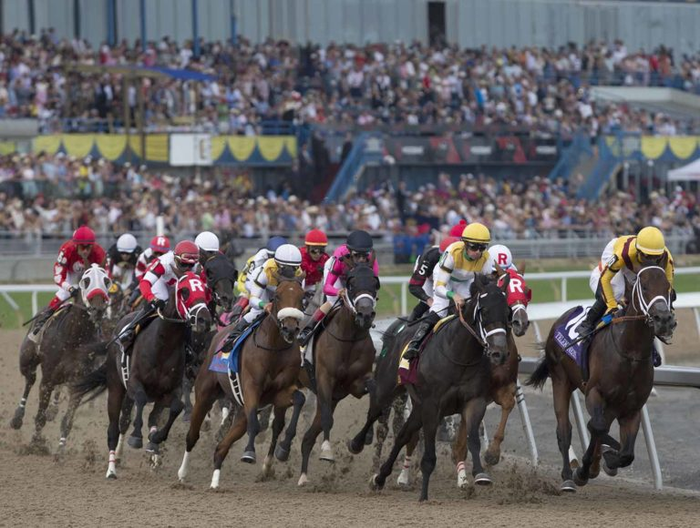 Toronto Ont.June 30, 2018.Woodbine Racetrack.159th Queen's Plate Stakes.Wonder Gadot  under Jockey John Velazquez,(pink silks  black cap) trails the pack on her way to capturing the Queen's Plate stakes for owner Gary Barber and trainer Mark Casse. michael burns photo
